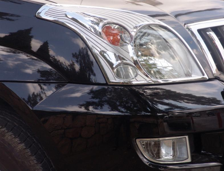 Black car front end and headlight after repair