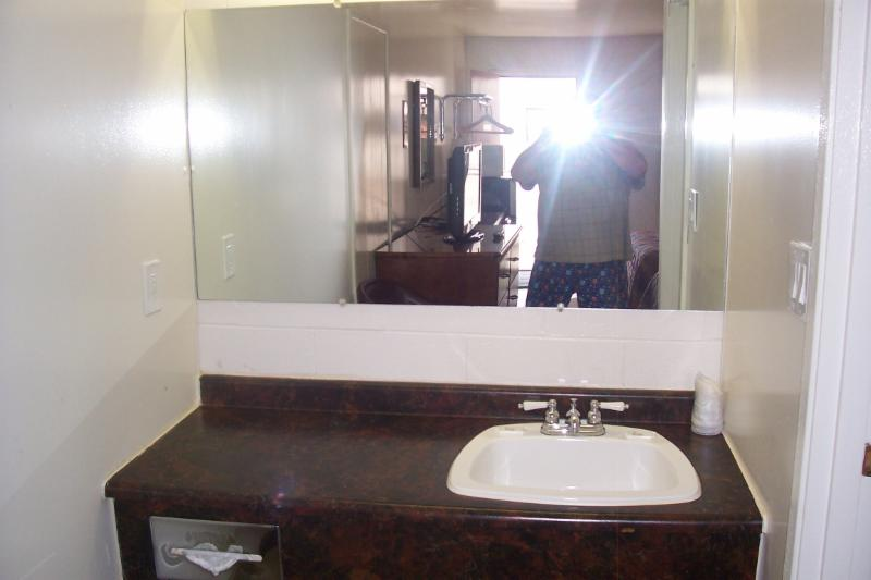 Bright vanity with full width mirror.     Climate controls for heat and air conditioning are client controlled