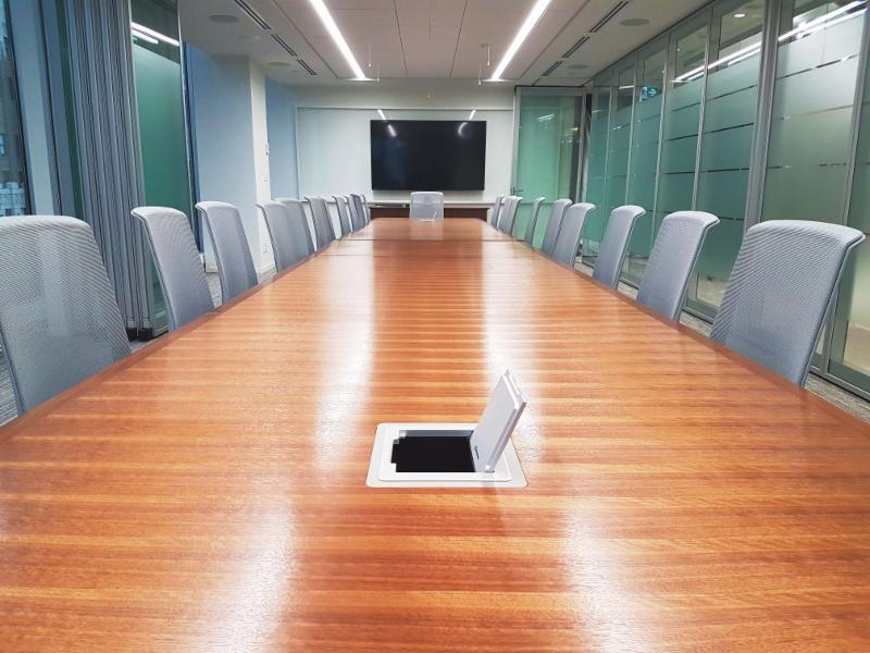 Divisible boardroom with Integrated Flip-top Control System and television display