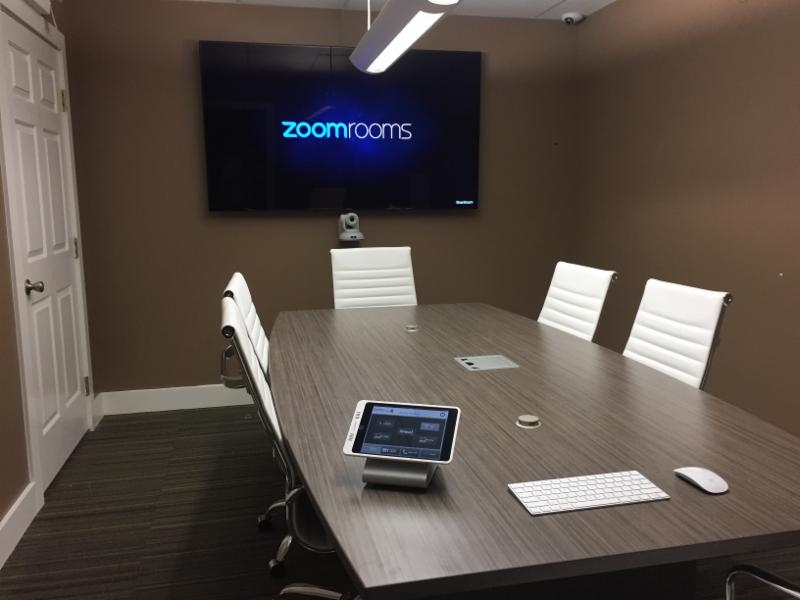 Zoom Room huddle room with touch screen control system, keyboard and wireless mouse