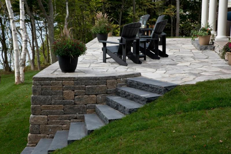This is an outdoor space we created with wallstone, slate, and granite. - Kings County Construction Ltd