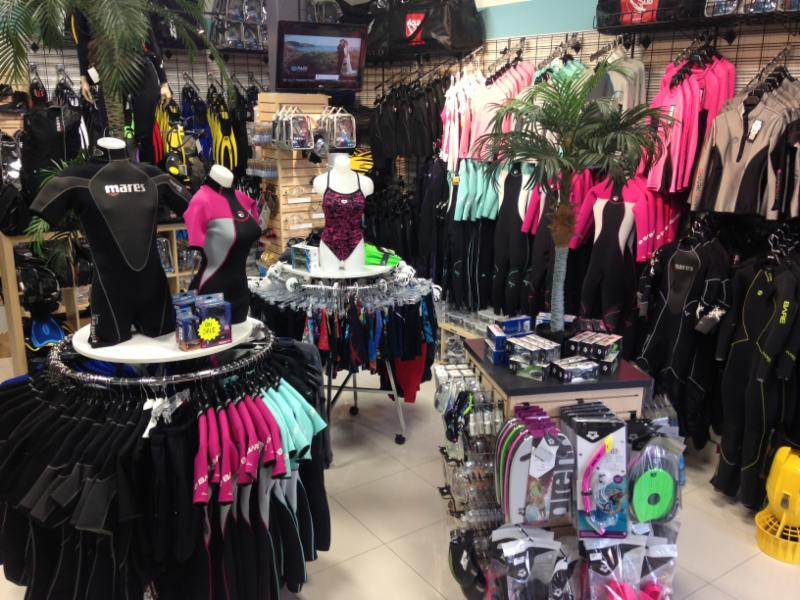 Pro shop full of scuba diving gear, snorkelling and water sports equipment.