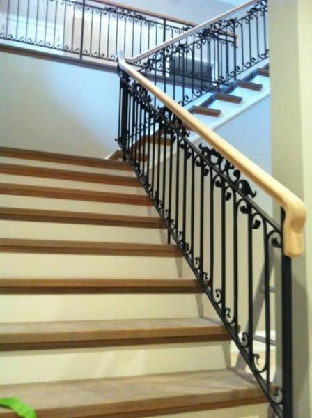 Hallaran woodworking custom designs and builds magnificent railings and stairs for your home, office