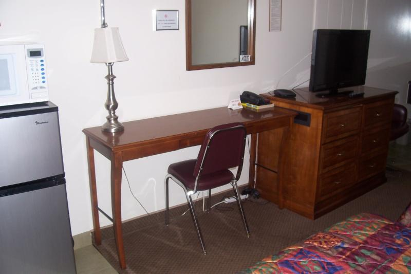 There is a desk, entertainment center, Fridge and Microwave in all our rooms.