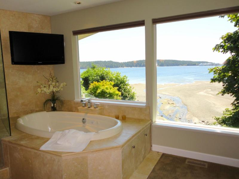 Sit and relax in the jetted tub overlooking the ocean at the beautiful Bayside Oceanfront home