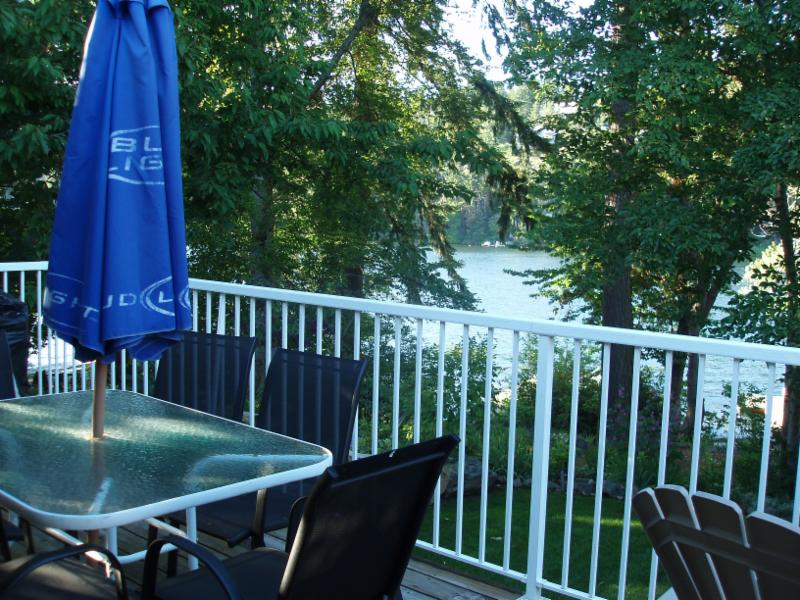 Deck view = sit and relax overlooking the lake, enjoy lakeside living