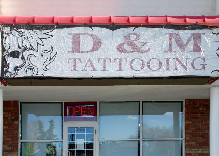 D m tattoo parlour edmonton ab 8119 99 street nw for Kitchen cabinets 99 street edmonton