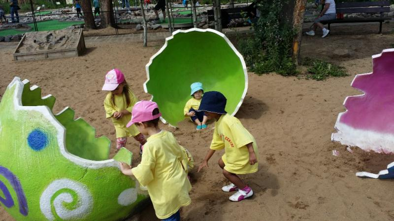 Children Playing at the park after visiting Jurassic Park