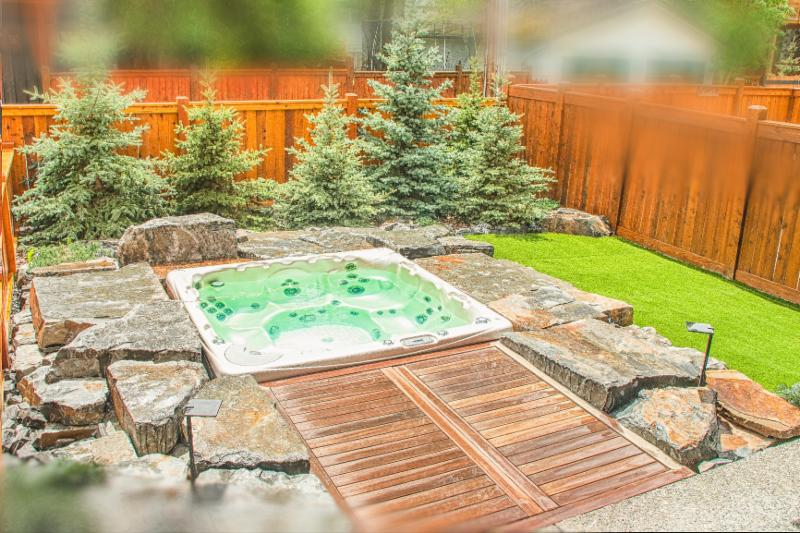 Sunken Hot Tub Feature, Stone Feature, Artificial Grass, Image, Backyard Landscaping Ideas, Solkor, Canmore, Banff, Outdoor Living Spaces