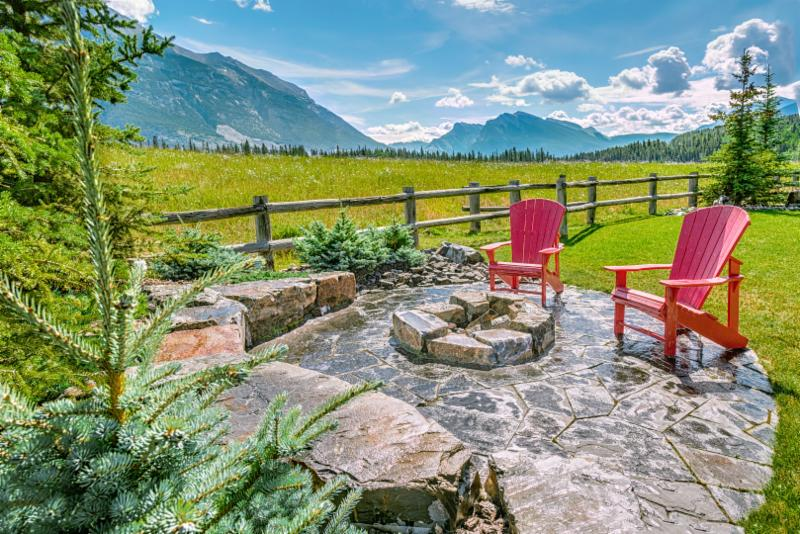 Flagstone Patio, Fire Pit, Rundle Stone Tailings, Stone Seating, Stone Retaining Wall, Muskoka Chairs, Patio Furniture, Fire Pit, Backyard Landscaping Ideas, Image, Landscaping, Construction, Solkor, Canmore, Banff