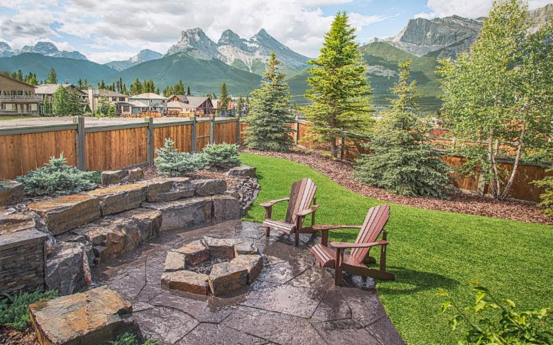 Flagstone Patio, Fire Pit, Kootenay Brown Stone Seating, Retaining Wall, Bark Nuggets, Shrubs, Trees, Patio Chairs, Artificial Grass, Backyard Landscaping Ideas, Image, Landscaping, Construction, Solkor, Canmore