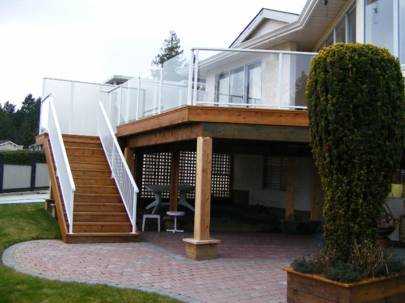 Custom built cedar deck, with vinyl waterproof deck surface.  Powder coated aluminum railings, with tempered glass privacy panels.     Built by Ridgewood, in Cordova Bay, Victoria BC