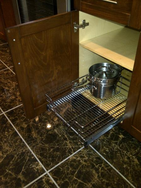 Convenience- pull out cabinet racks in a custom kitchen.