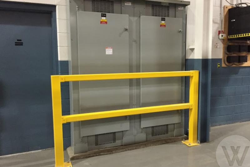 Bollards are typically used as guarding to prevent access to a specific area. In this case it is for safety to protect workers from the electrical panel.