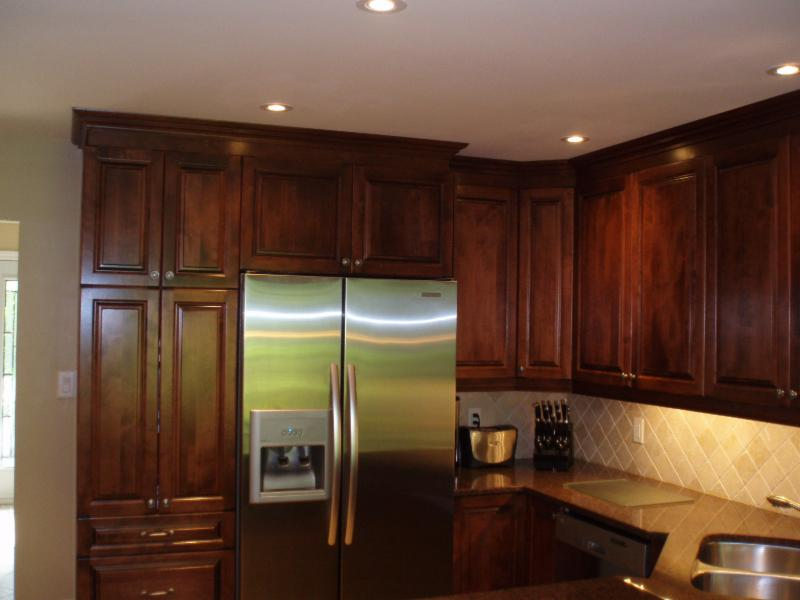 Open kitchen in Orleans with a French Provencal look. This eat in kitchen had dated cabinets and a backs plash that did it no justice. The design was simple and remained mostly the same.
