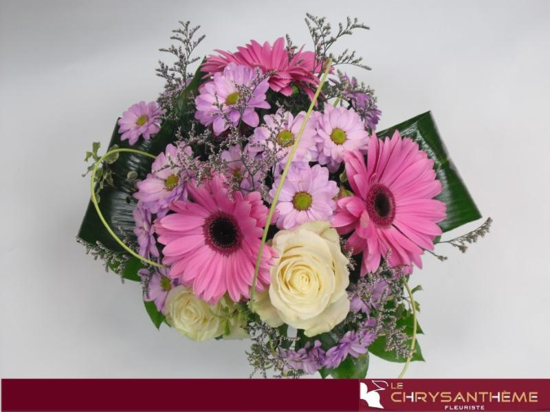 Floral arrangement composed of Gerberas, Lys, Marguerite.