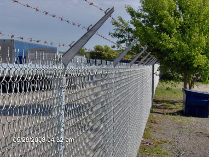 Commercial security chain link fence, six feet high plus three strands barb wire in Brantford, ON.