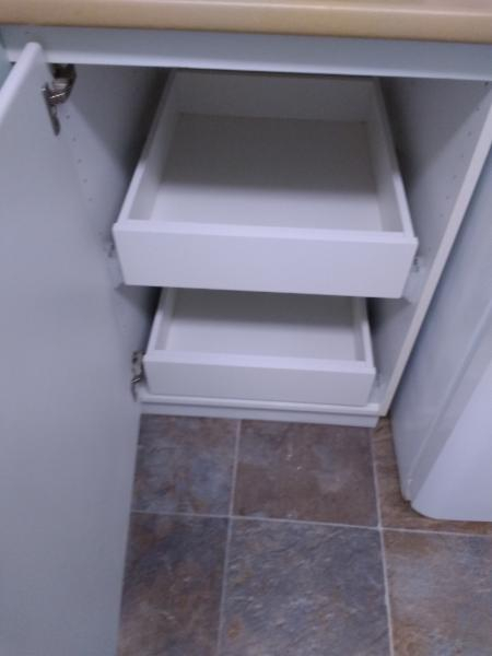 After:  Updated option pull out shelving with drawers makes finding items easy