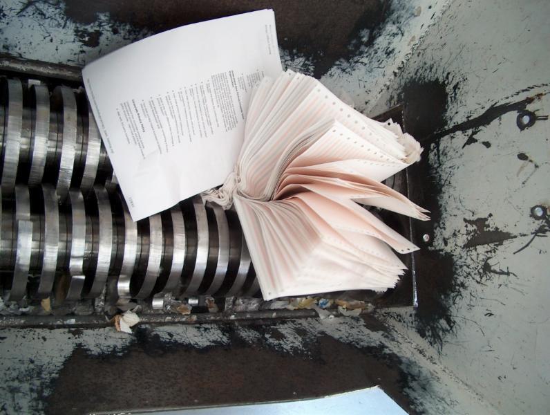 Documents passing through knives of mobile shredder