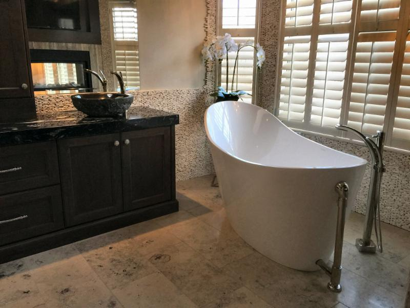 For this stunning renovation we used a muted limestone for the floor and a beachsand stacked pebble on the feature wall of the ensuite. Our homeowner LOVES the spa-like retreat(Cochrane Floors & More)