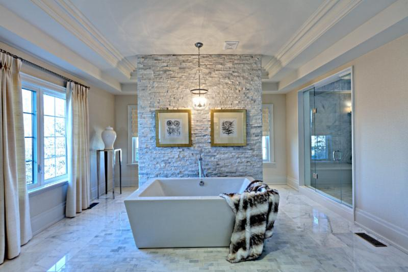 This amazing spa like retreat is layered in floor to ceiling Carrara marble. Using various sizes, textures & patterns, there's a lot to absrob & enjoy from this master ensuite (Cochrane Floors & More)