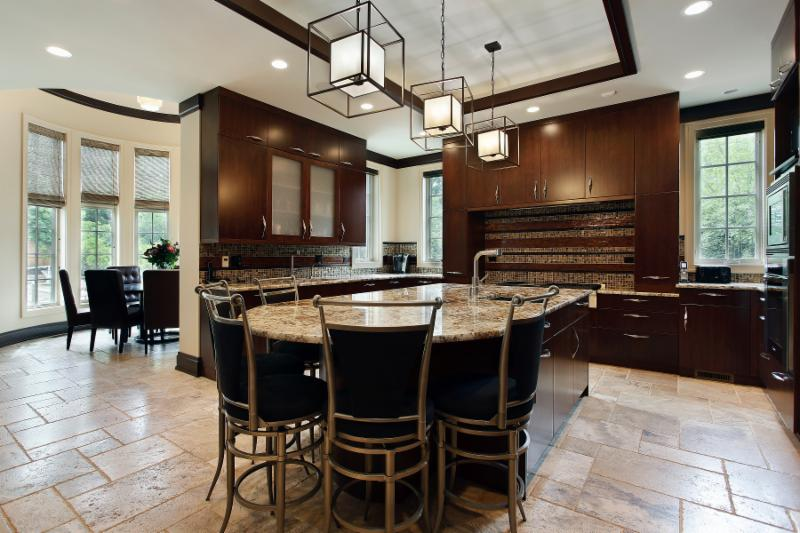 Cobbled travertine throughout the kitchen and nook keep the hope bright and airy. The heated floor system kicks in to keep in comfortable even in our cold Canadian winters. (Cochrane Floors & More)
