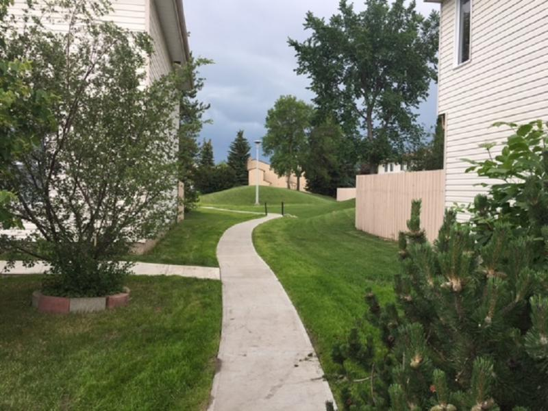 New cement sidewalks and landscaping at condo complex in South Edmonton. Repairs made to dangerous existing broken sidewalks. Visit our website to see more  photos of our concrete work at - http://www.anotherconcretecompany.ca/