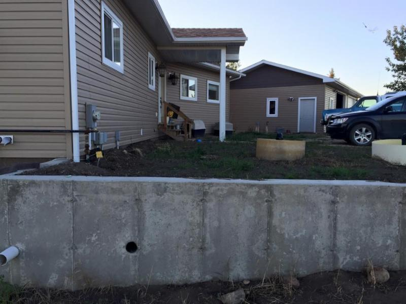 Concrete retaining wall installation including forms and new cement for our happy client in Fort Saskatchewan - Edmonton