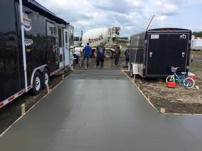 Edmonton Commercial concrete contractor pouring and placing a cement para ramp at a commercial business in Sherwood Park Alberta Canada