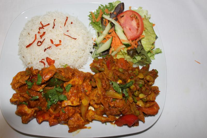 Lunch Special Chicken Curry serves with mix vegetable curry, rice, and salad
