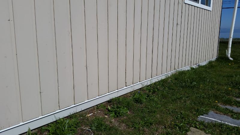 Cut away and replaced rotted siding and applied a drip flashing