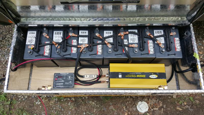 Six 6 volt batteries with MPPT Solar Controller and 3000 watt Pure Sine Inverter in a portable power box.