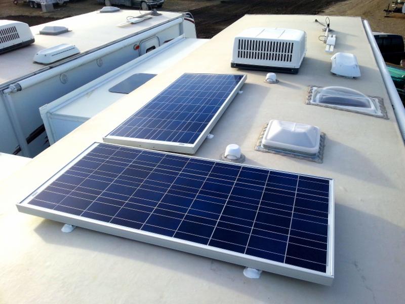 Dual 150 Watt Enerwatt Solar Modules mounted on top of a customer's RV