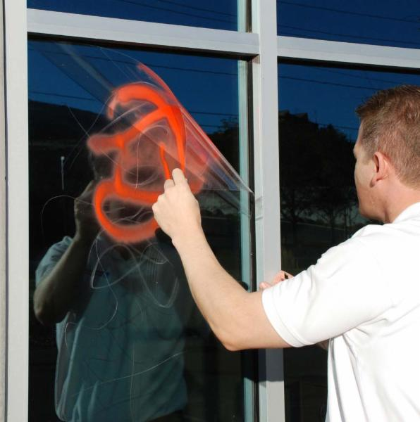Anti-graffiti film protects your windows from spray paint, scratches and helps to prevent break-ins.